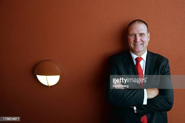 Neville 'Nev' Power chief executive officer of Fortescue Metals Group Ltd poses for a photograph during the Diggers and Dealers mining forum in...