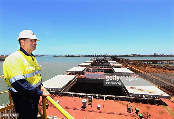 Neville 'Nev' Power chief executive officer of Fortescue Metals Group Ltd stands for a photograph above a bulk carrier berthed at the company's Herb...
