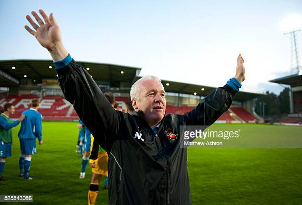 Neville Powell the head coach / manager of Bangor City celebrates winning the game 3-2 on aggregate