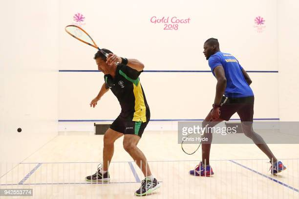 Neville Sorrentino of the British Virgin Islands competes against Shawn Simpson of Barbados during the Squash Mens Singles on day two of the Gold...