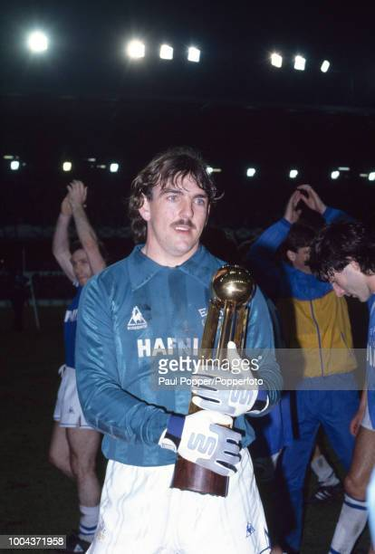 Neville Southall of Everton celebrates with the trophy after their 20 victory over West Ham United had clinched the Canon League Division One...