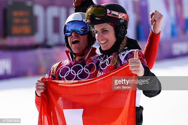 Nevin Galmarini of Switzerland celebrates winning the silver medal in the Snowboard Men's Parallel Giant Slalom Finals and Patrizia Kummer of...