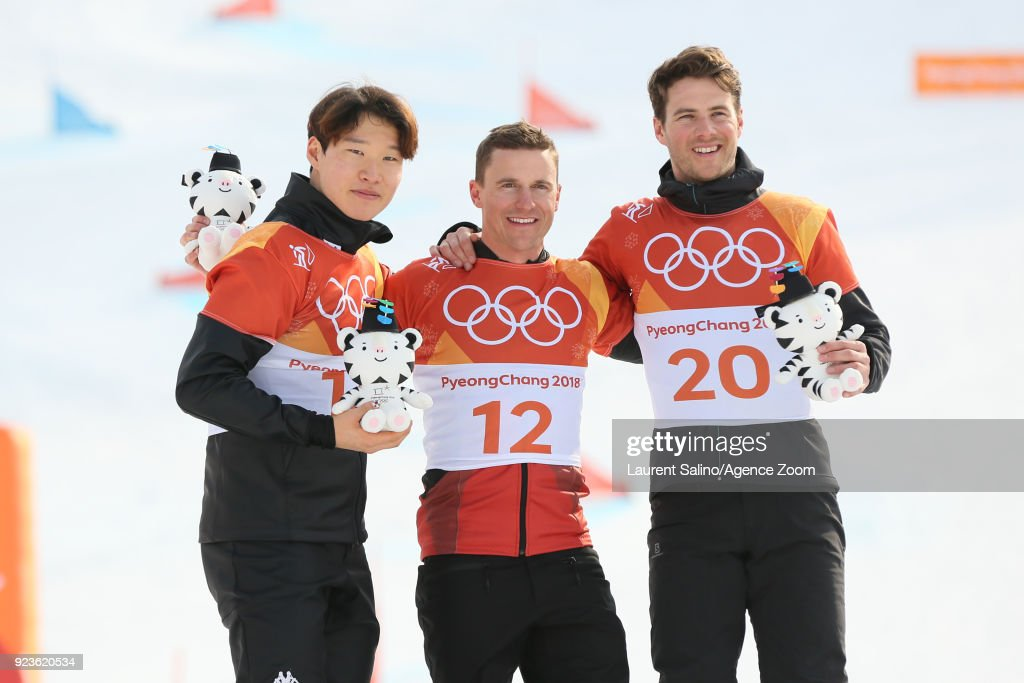 Nevin Galmarini of Switzerland takes 1st place, Sangho Lee of Korea takes 2nd places, Zan Kosir of Slovenia takes 3rd place during the Snowboarding Men's and Women's Parallel Giant Slalom Finals at Pheonix Snow Park on February 24, 2018 in Pyeongchang-gun, South Korea.