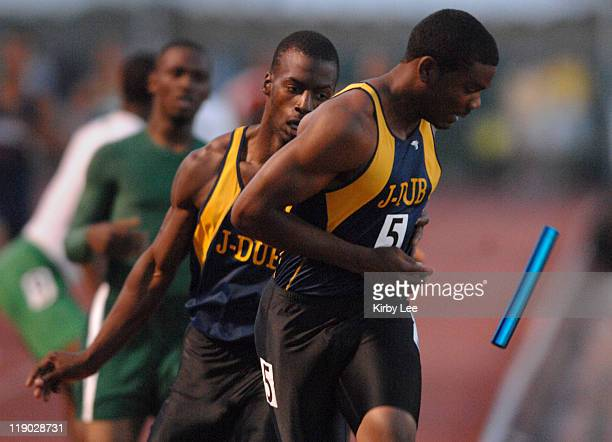 Nevin Gutieriez of Riverside JW North High drops the baton on a handoff from Tommy Curry in the 1600meter relay in the CIF State Track Field...