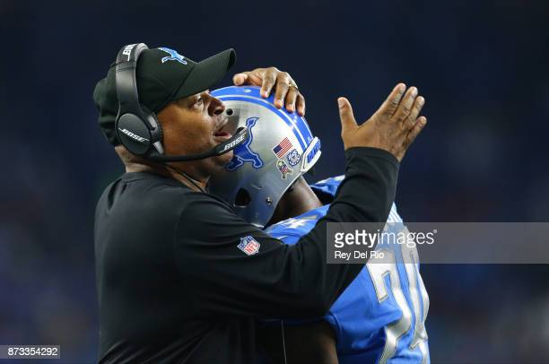 Nevin Lawson of the Detroit Lions celebrates his fumble for a touchdown with head coach Jim Caldwell of the Detroit Lions during the game against the...