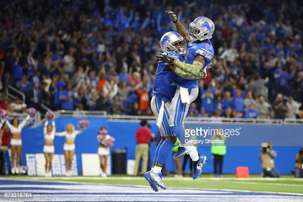 Nevin Lawson of the Detroit Lions celebrates his touchdown run with a teammate after recovering a fumble against the Cleveland Browns during the...