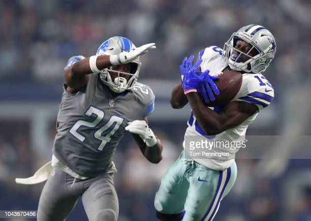 Nevin Lawson of the Detroit Lions tries to break up the pass caught by Michael Gallup of the Dallas Cowboys in the first quarter of a game at ATT...
