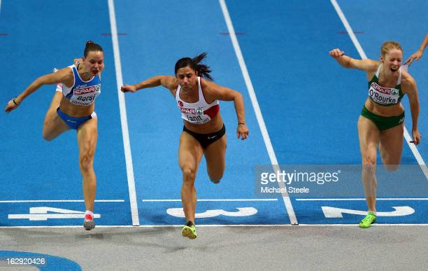 Nevin Yanit of Turkey crosses the line to win gold in the Women's 60m Hurdles Final during day one of the European Athletics Indoor Championships at...