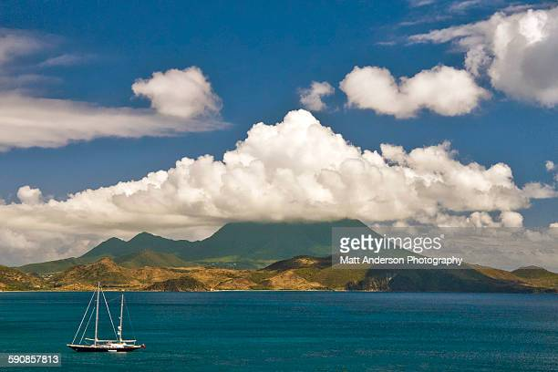 nevis view as seen from st kitts - st. kitts stock photos and pictures