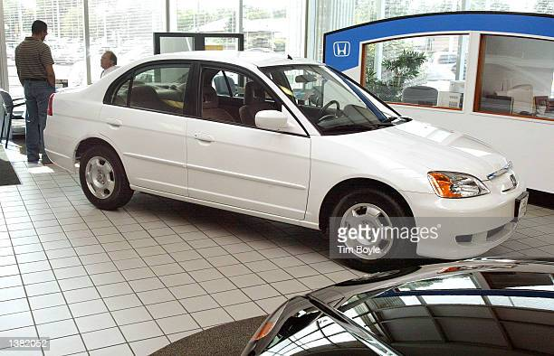 New 2003 Honda Civic Hybrid vehicle is shown in the showroom of O'Hare Honda September 13, 2002 in Des Plaines, Illinois. The gasoline-electric power...
