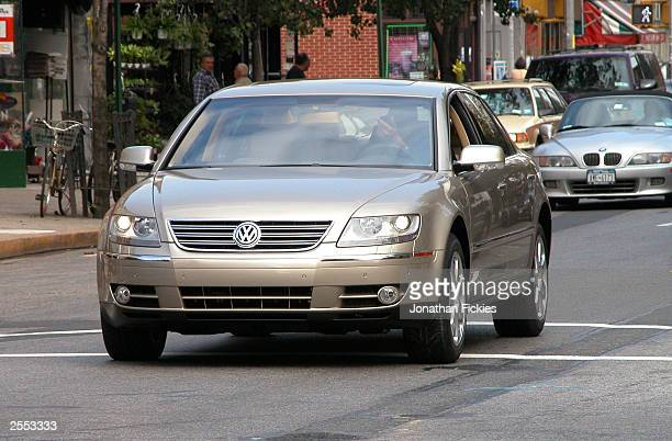 A new 2004 Volkswagen Phaeton luxury sedan not yet available in the US drives on a street for a print advertisement photo shoot October 1 2003 in the...