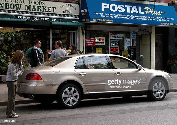 A new 2004 Volkswagen Phaeton luxury sedan not yet available in the US is parked on a street for a print advertisement photo shoot October 1 2003 in...
