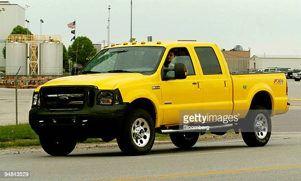 A new 2005 Ford F350 truck is test driven on the road outside the Kentucky Ford Truck plant in Louisville Kentucky April 19 2004 The front grill of...