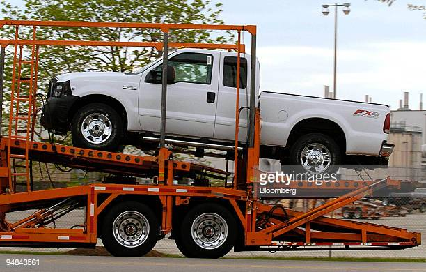 """New 2005 Ford """"Super Truck"""" is seen on a car carrier outside the Kentucky Ford Truck plant in Louisville, Kentucky, April 19, 2004. The front grill..."""