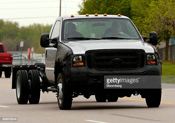 A new 2005 Ford Super Truck is test driven on the road outside the Kentucky Ford Truck plant in Louisville Kentucky April 19 2004 The front grill of...