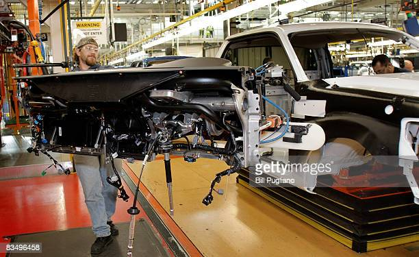 New 2009 Ford F150 trucks go through the assembly line October 30 2008 at the Dearborn Truck Plant in Dearborn Michigan Ford plans to add 1000 jobs...