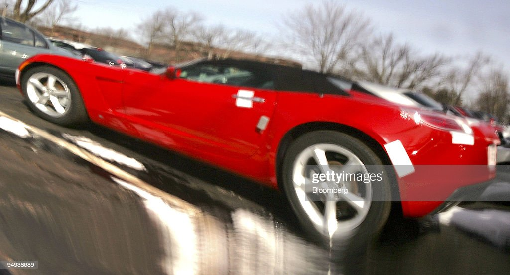 A New 2009 Saturn Sky Roadster Is Reflected In The Chassis Of Another Sky  On The