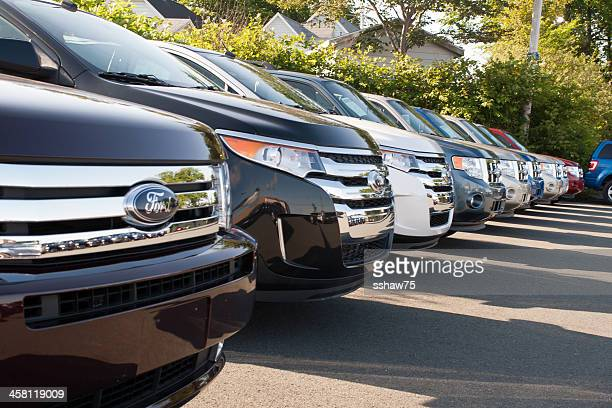 new 2011 ford suvs on dealership lot - ford motor company stock pictures, royalty-free photos & images