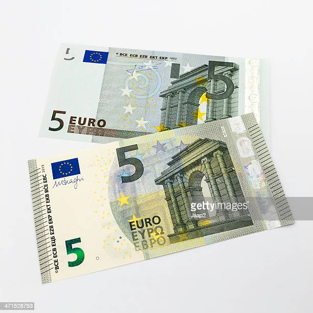 new 2013 five euro banknote on top of previous model - five euro banknote stock photos and pictures