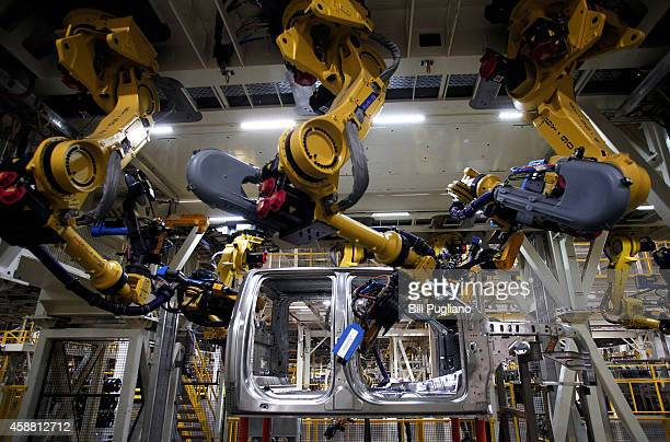 A new 2015 Ford F150 truck goes through the assembly line at the Ford Dearborn Truck Plant November 11 2014 in Dearborn Michigan The new 2015 F150 is...