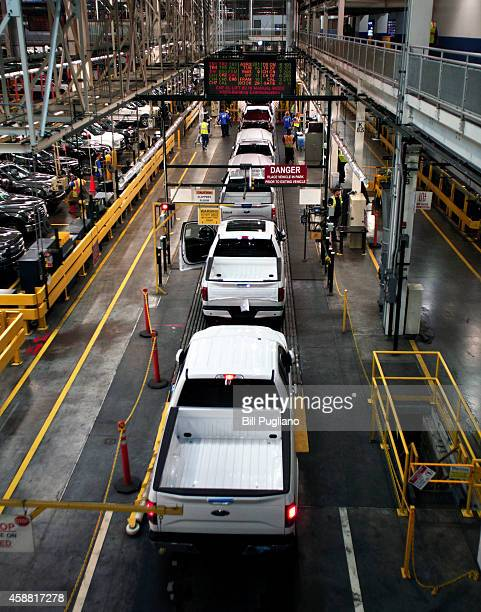 New 2015 Ford F150 trucks go through a quality control inspection on the assembly line at the Ford Dearborn Truck Plant November 11 2014 in Dearborn...