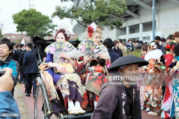 New 20yearold arrive by a rickshaw at their comingofage ceremony at Kitakyushu Media Dome on January 7 2018 in Kitakyushu Fukuoka Japan Kitakyushu...