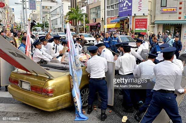 A new 20yearold is arrested by police as he drives an illegally modified car ahead of the comingofage ceremony on January 8 2017 in Naha Okinawa Japan