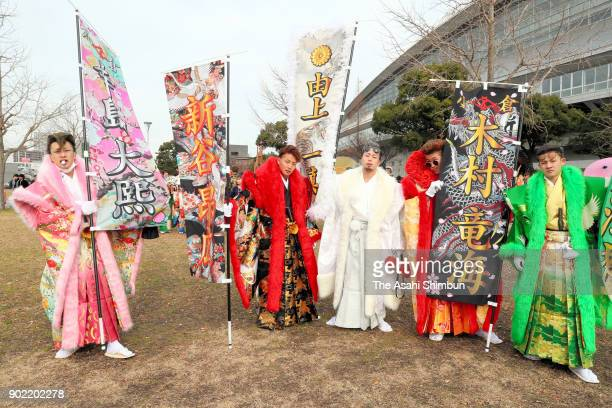 New 20yearold pose for photographs with flags their names on prior to the comingofage ceremony at Kitakyushu Media Dome on January 7 2018 in...