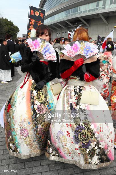 New 20yearold wearing vivid dresses pose for photographs prior to their comingofage ceremony at Kitakyushu Media Dome on January 7 2018 in Kitakyushu...