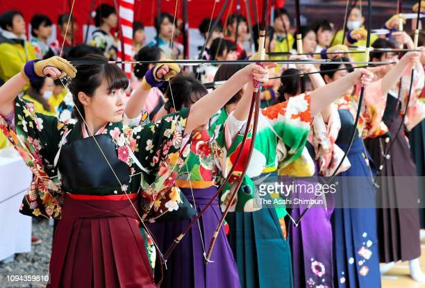 New 20yearsold wearing kimono take aim during an archery event to celebrate their comingofage at Sanjusangendo Temple on January 13 2019 in Kyoto...