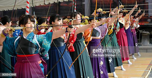 New 20yearsold wearing kimono take aim during an archery event to celebrate their comingofage at Sanjusangendo Temple on January 12 2016 in Kyoto...