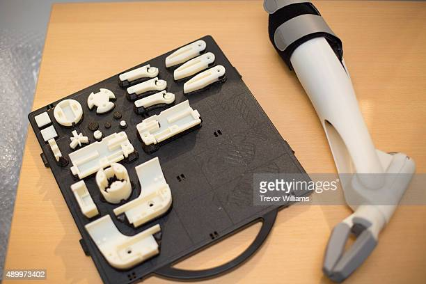 A new 3D printed prosthetic arm and its parts are displayed on September 21 2015 in Okayama Japan The prosthetic arm 'Finch' that can be massproduced...