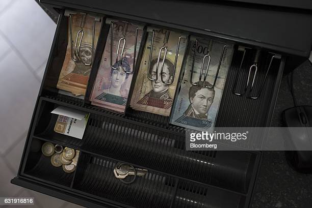 New 500 Bolivar banknotes right sit in a cash register at a coffee shop in Caracas Venezuela on Tuesday Jan 17 2017 Since Venezuela's President...