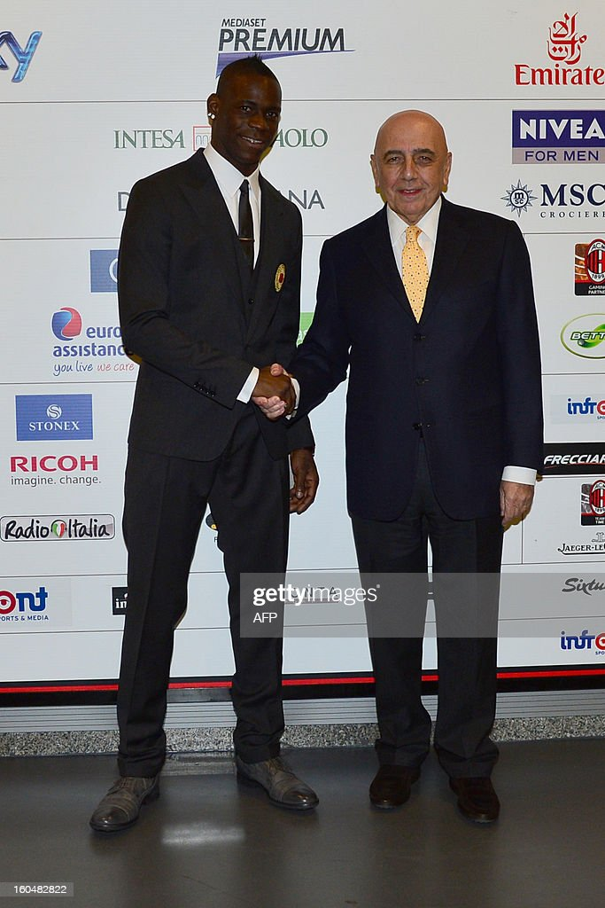 New AC Milan player, Italian striker Mario Balotelli (L) poses with AC Milan sporting director Adriano Galliani during a press conference for his presentation as a new player on February 1, 2013 at San Siro Stadium in Milan.