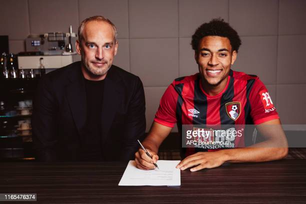 New AFC Bournemouth Signing Arnaut Danjuma signs his contract with Chief Executive Neill Blake at Vitality Stadium on August 01 2019 in Bournemouth...