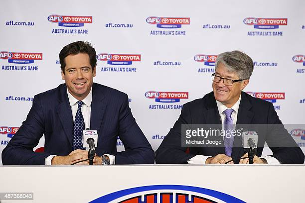 New AFL CEO Gillon McLachlan and Commission Chairman Mike Fitzpatrick react to the media during an AFL press conference at AFL House on April 30 2014...