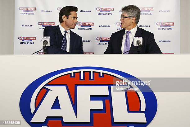 New AFL CEO Gillon McLachlan and Commission Chairman Mike Fitzpatrick shake hands during an AFL press conference at AFL House on April 30 2014 in...