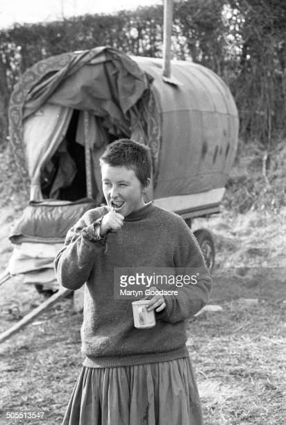 A New Age traveller brushing her teeth outside a gipsy caravan at an encampment near Hereford 1987