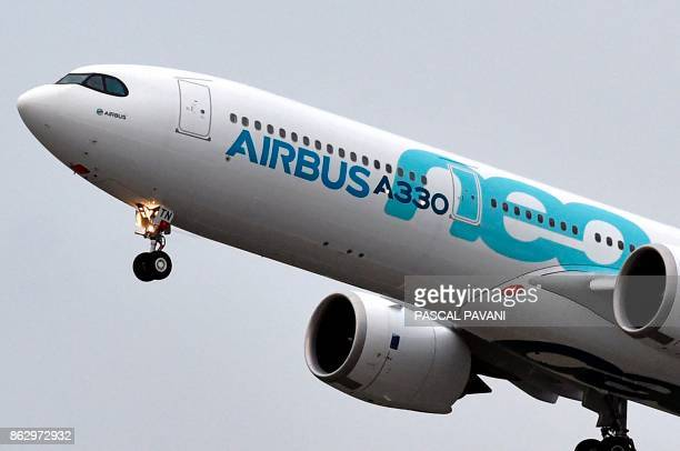 A new Airbus A330neo makes its first flight over Colomiers on October 19 2017 after taking off from the ToulouseBlagnac airport near Toulouse / AFP...