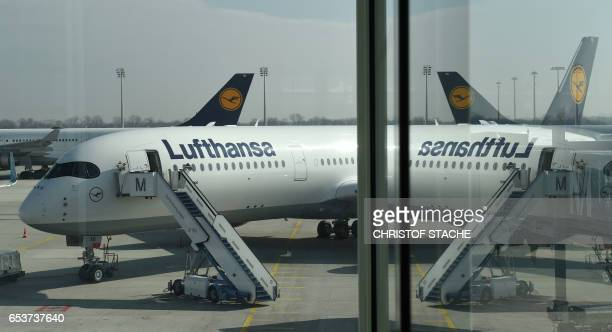 A new aircraft Airbus A 350 of the German airline Lufthansa is pictured at the Lufthansa terminal of the FranzJosefStrauss airport in Munich southern...