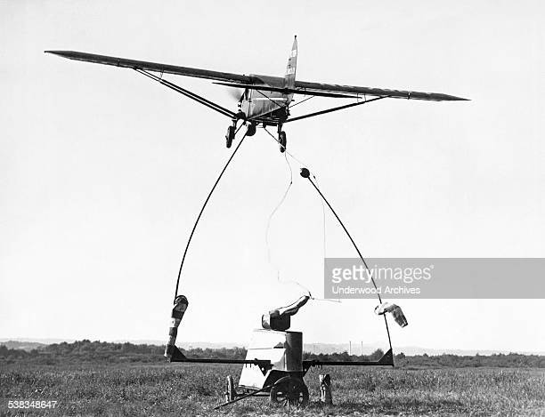 A new airmail pickup device was demonstrated at Washington Hoover Airport today Washington DC September 10 1931 The airplane has snagged the cord...