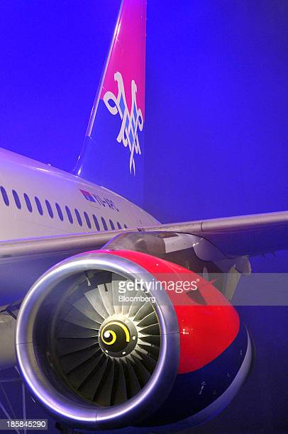 A new AirSerbia logo sits on the tail fin of an Airbus A319 aircraft rebranded from Jat Airways during a news conference at Nikola Tesla airport in...