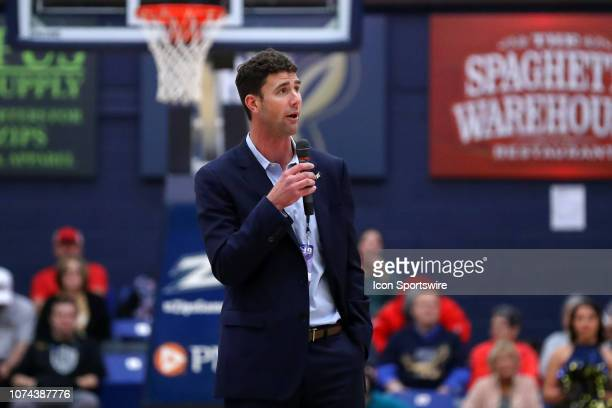 New Akron Zips head football coach Tom Arth addresses the fans during a timeout during the first half of the college basketball game between the...