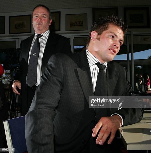 New All Black rugby captain Richie McCaw talks as coach Graeme Henry looks on at the Christchurch Rugby club after a press conference to confirm his...