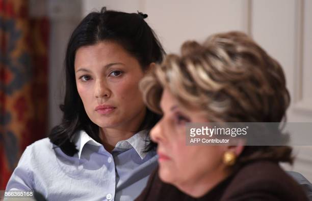 New alleged victim of film producer Harvey Weinstein actor and model Natassia Malthe looks at ther Attorney Gloria Allred speaking during a press...