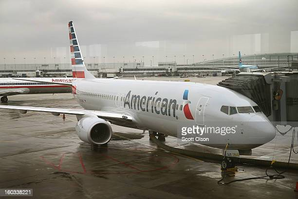 A new American Airlines 737800 aircraft featuring a new paint job with the company's new logo sits at a gate at O'Hare Airport on January 29 2013 in...