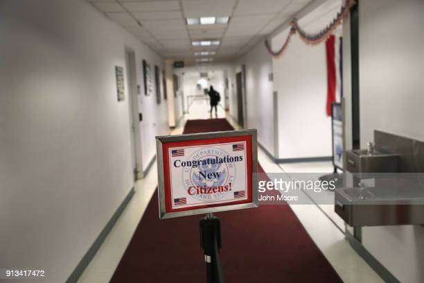 A new American citizen departs following a naturalization ceremony on February 2 2018 in New York City US Citizenship and Immigration Services swore...
