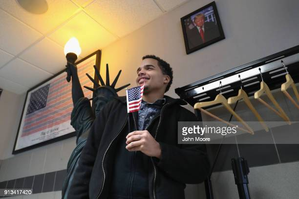 A new American citizen poses for photos following a naturalization ceremony on February 2 2018 in New York City US Citizenship and Immigration...