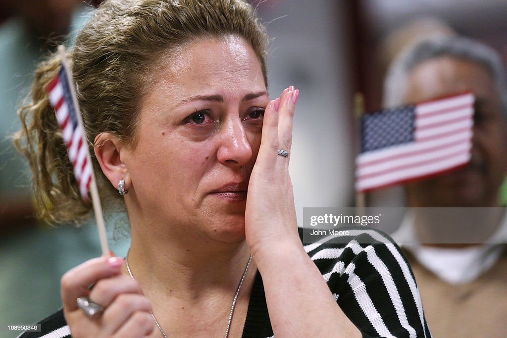 New American citizen Sabaheta Sinanovic from Montenegro wipes a tear after taking the oath of citizenship at a naturalization ceremony held at the U.S. Citizenship and Immigration Services (USCIS), office on May 17, 2013 in New York City. One hundred and fifty immigrants from 38 different countries became U.S. citizens at the event. Some 11 million undocumented immigrants living in the U.S. stand to eventually gain American citizenship if Congress passes immigration reforms currently being negotiated in Washington D.C.