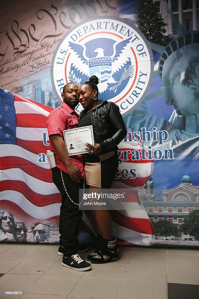 New American citizen Shaw-nee Krishna Best from Jamaica poses for photos with her husband following a naturalization ceremony at the U.S. Citizenship and Immigration Services (USCIS), office on May 17, 2013 in New York City. One hundred and fifty immigrants from 38 different countries became U.S. citizens at the event. Some 11 million undocumented immigrants living in the U.S. stand to eventually gain American citizenship if Congress passes immigration reforms currently being negotiated in Washington D.C.